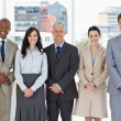 Smiling business team standing upright side by side with their h — Stock Photo #13908674