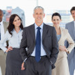 Business team smiling and standing — Stock Photo #13908789