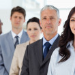 Young smiling executive followed by her full business team — Stock Photo