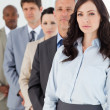 Serious executive woman standing upright in front of her busines — Stock Photo #13908829