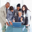 Mature and serious manager giving explanations to his team with — Stock Photo
