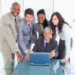 Four business standing behind their manager proudly showi — Stock Photo #13908950