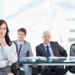 Confident businesswoman sitting with her hand on her chin while — Stock Photo