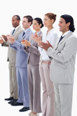 Dressed in suits smiling and applauding — Stock Photo