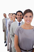 Close-up of workmates in a single line looking straight — Stock Photo