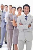 Close-up of a business team crossing their arms in a single line — Stock Photo