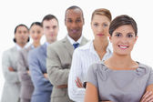 Close-up of a business team in a single line crossing their arms — Stock Photo