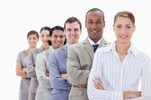 Close-up of smiling colleagues dressed in suits crossing their a — Stock Photo