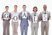 Business team holding the letters of GOALS — Stok fotoğraf