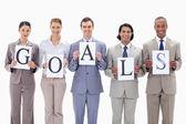 Obchodní tým držící dopisy cílů — Stock fotografie