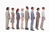 Profil d'une équipe de commerciaux dans une seule ligne — Photo
