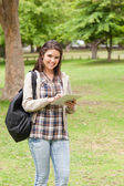 Young student using a touch pad — Stock Photo
