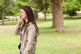 Side view of a teenager phoning — Stock Photo