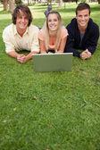 Three smiling students — Stock Photo