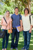 Three students posing side by side — Stock Photo
