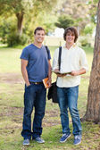 Portrait of two smiling male students posing — Stock Photo