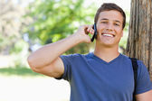 Close-up of a muscled young man on the phone — Stock Photo
