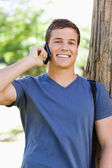 Portrait of a muscled young man on the phone — Stock Photo