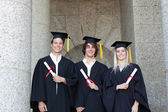 Portrait of graduates holding their diploma — Stock Photo