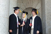Happy graduates speaking together — Stok fotoğraf