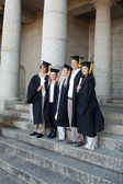 Graduates posing while smiling — Stock Photo