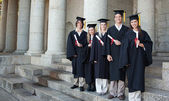 Five happy graduates posing — Stock Photo