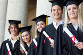 Close-up of five graduates posing — Stock Photo
