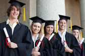 Close-up of five graduates students posing — Stock Photo