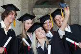Close-up of five graduates taking a picture of themselves — Stock Photo