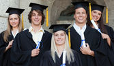 Close-up of five happy graduates posing — Stock Photo