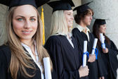 Close-up of a blonde graduate with blue eyes — Stock Photo