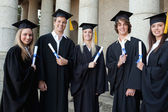 Graduates together — Stockfoto
