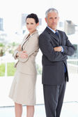 Two serious business standing in a bright room — Stock Photo