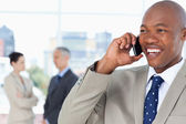 Young manager looking towards the side while talking on the phon — Stock Photo