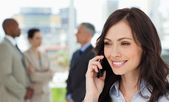 Executive woman talking on the cell phone — Stock Photo
