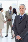 Serious manager standing upright with his hands crossed — Stock Photo