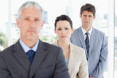 Young serious executive following his business team — Stock Photo
