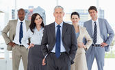 Business team smiling and standing — Stock Photo