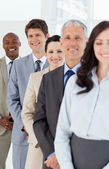 Young smiling employees which are laughing while following leade — Stock Photo