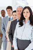 Serious executive woman standing upright in front of her busines — Stock Photo