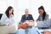 Executives shaking hands while their director and two colleagues — Stock Photo