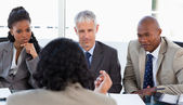 A business team is earnestly listening to an associate — Stock Photo