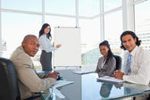 Business team almost smiling in a meeting room during a presenta — Stock Photo