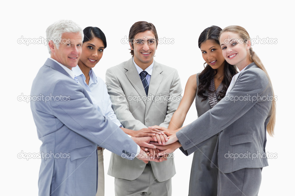 Putting their hands on each others against white background — Stock Photo #13900860