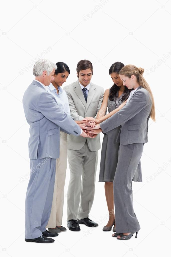 Business putting their hands on each others against white background — Stock Photo #13900862