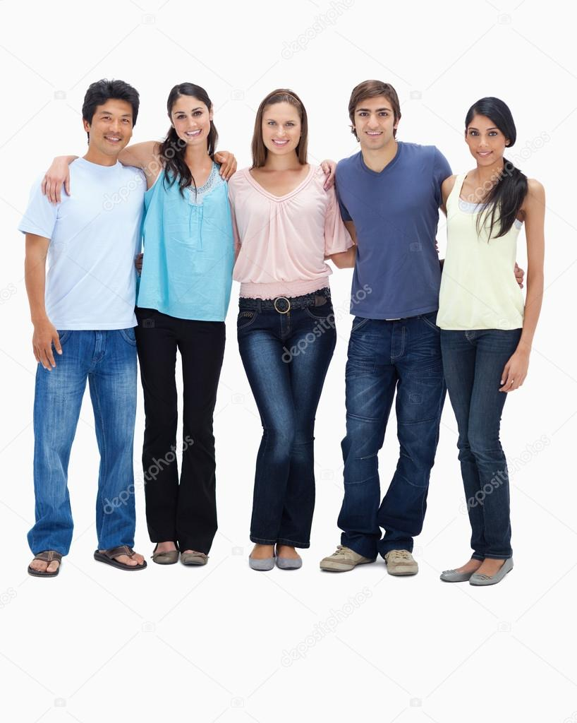 Friends smiling arm in arm against white background — Stock Photo #13906175