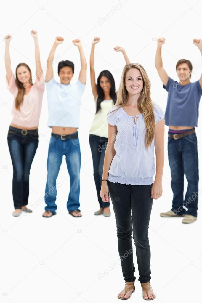 Woman smiling with with their arms raised behind her against white background — Stock Photo #13906287