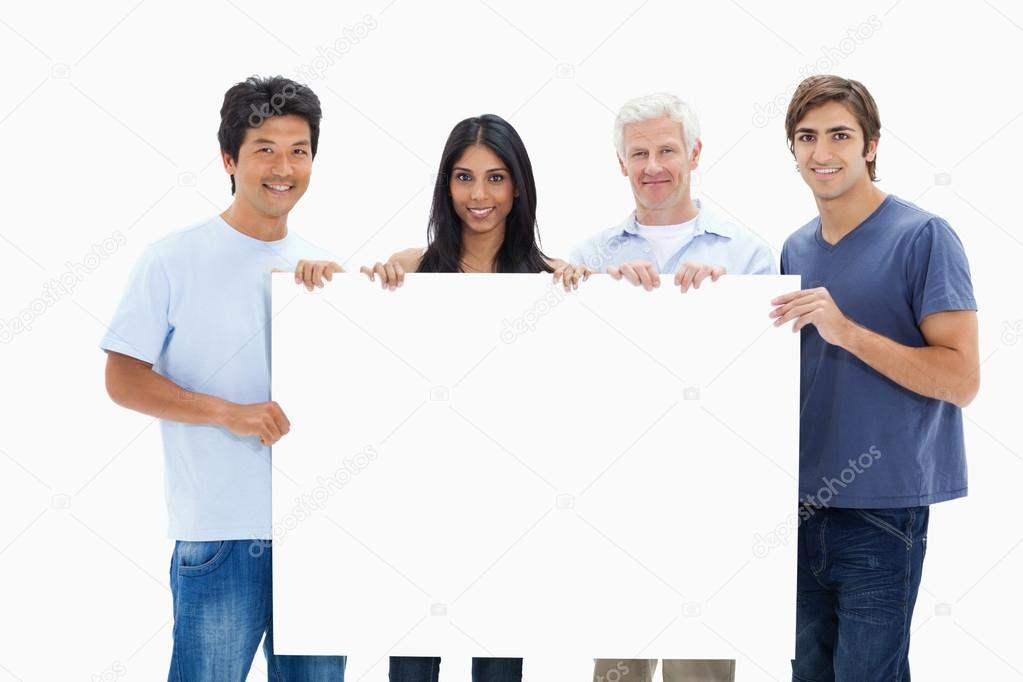 In jeans holding a big sign against white background  Stock Photo #13906303