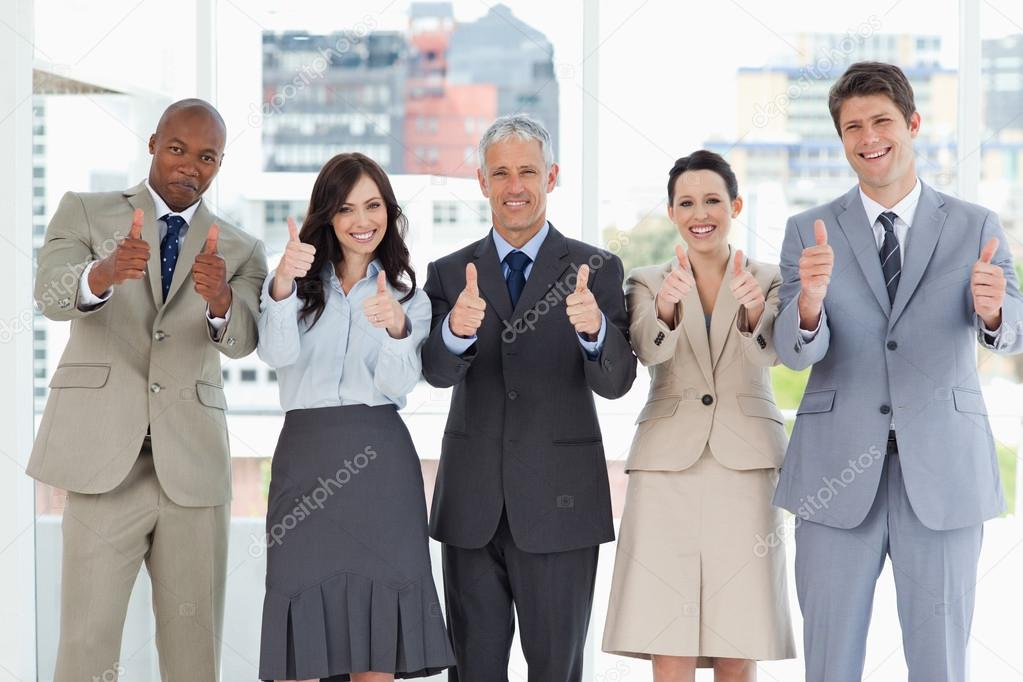 Business team putting their thumbs up to show a success — Stock Photo #13908677