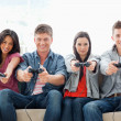 A group with arms out smiling as they play games together — Stock Photo